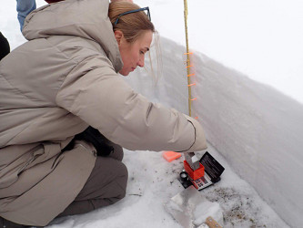 Senior Researcher V.A. Lobkina conducts in-situ observation of seasonal stratified snow cover